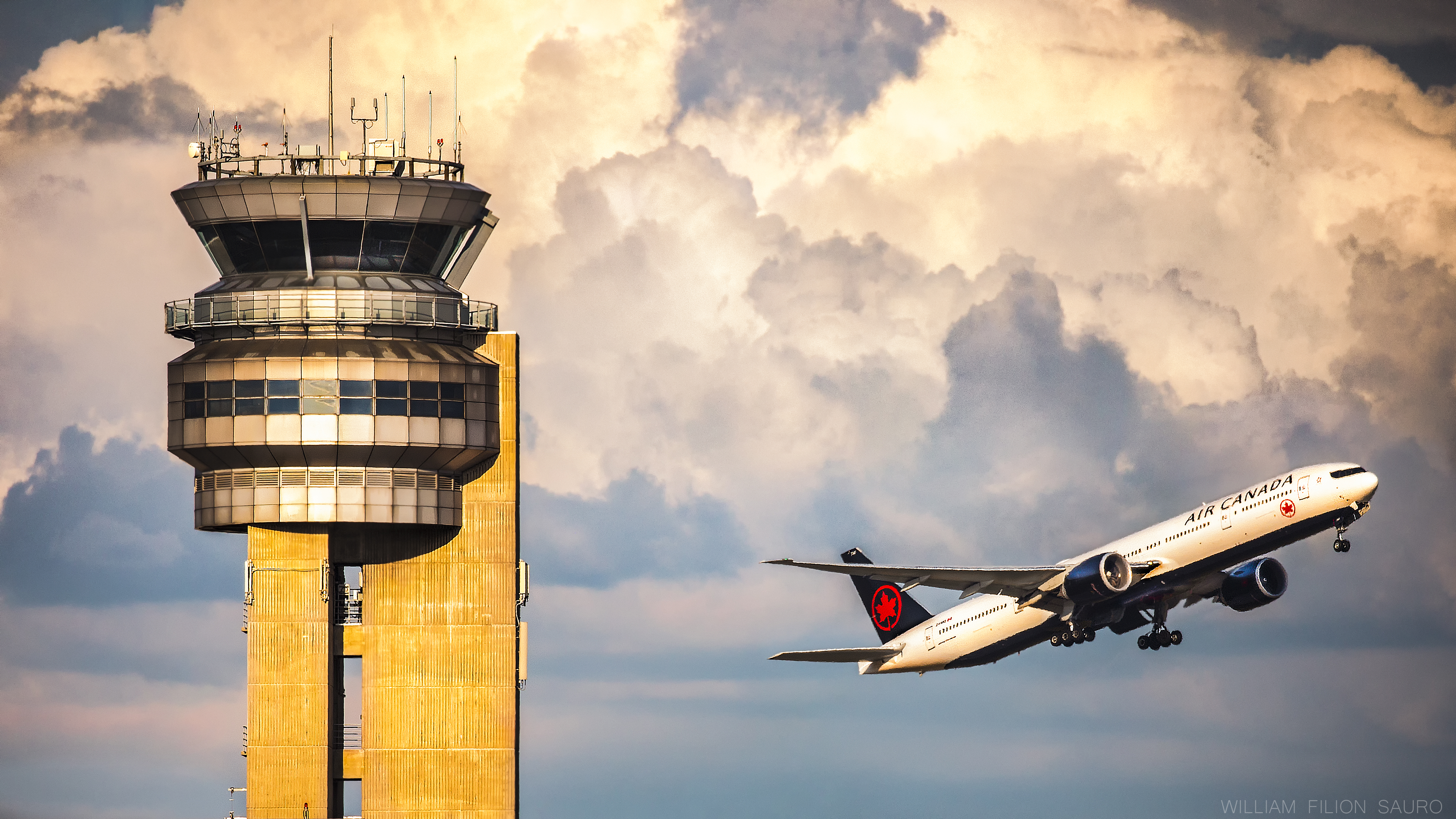 A gorgeous shot of an Air Canada 777 taking off in front of YUL's iconic control tower. Photo submitted by William Filion Sauro (Instagram user @etops_exposure) using #skiesmag.