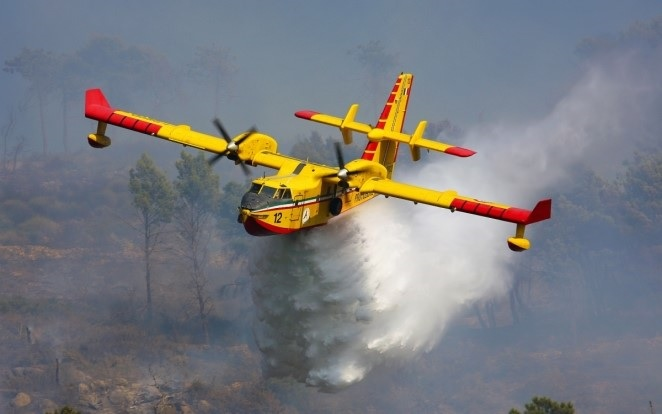 Known as the Water Bomber, the aircraft is able to scoop water rapidly into its belly (up to 1,600 gallons in 12 seconds) from a natural water source near a forest fire, and drop it on the fire without having to return to a remote water station for refilling. LMS Photo
