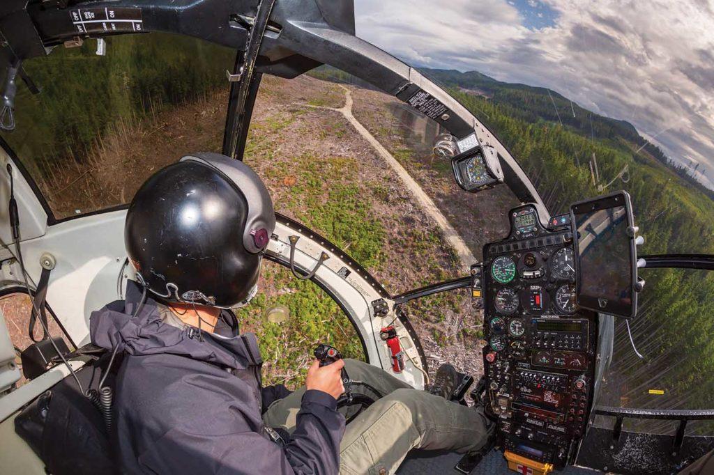 Pilot Ben Anderson makes his way to a job site in an MD 500. Heath Moffatt Photo