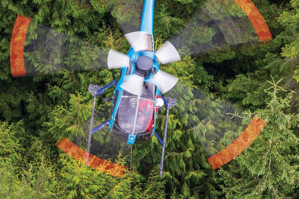 Mike Aldersey is the most experienced pilot at West Coast Helicopters, having recorded more than 29,000 flight hours. Here, he flies cedar shakes on the end of a long line. Heath Moffatt Photo