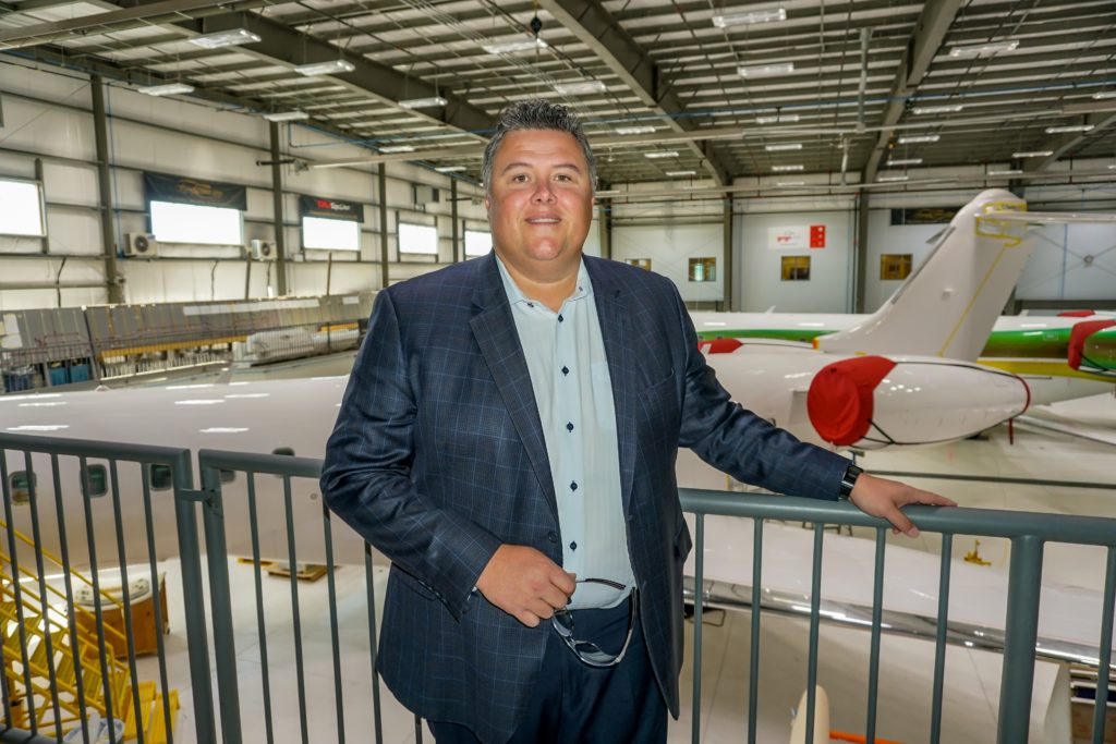 Eric Gillespie stands in the hangar at Flying Colours Corp. in Peterborough, Ont. The company's three locations are enjoying tremendous growth as the demand for aircraft completions, modifications, painting and maintenance services continues. Lisa Gordon Photo