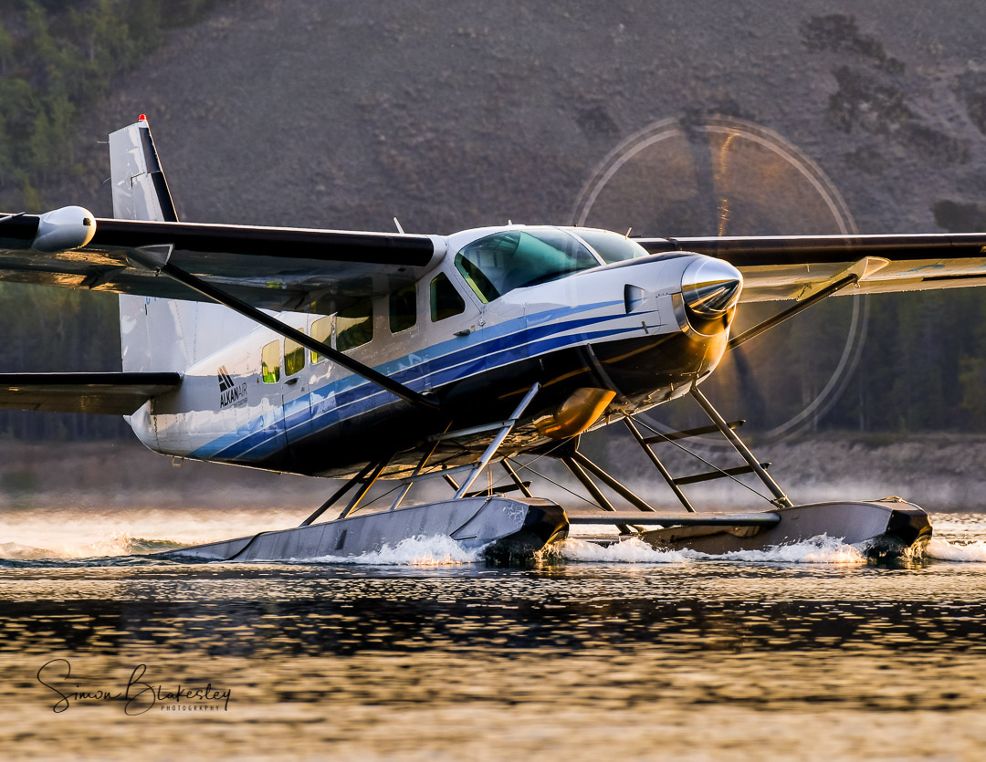 Alkan Air's Cessna 208 Caravan bathed in the morning sunlight on Schwatka Lake in Whitehorse. Photo submitted by Simon Blakesley (Instagram user @simon_blakesley) using #skiesmag.
