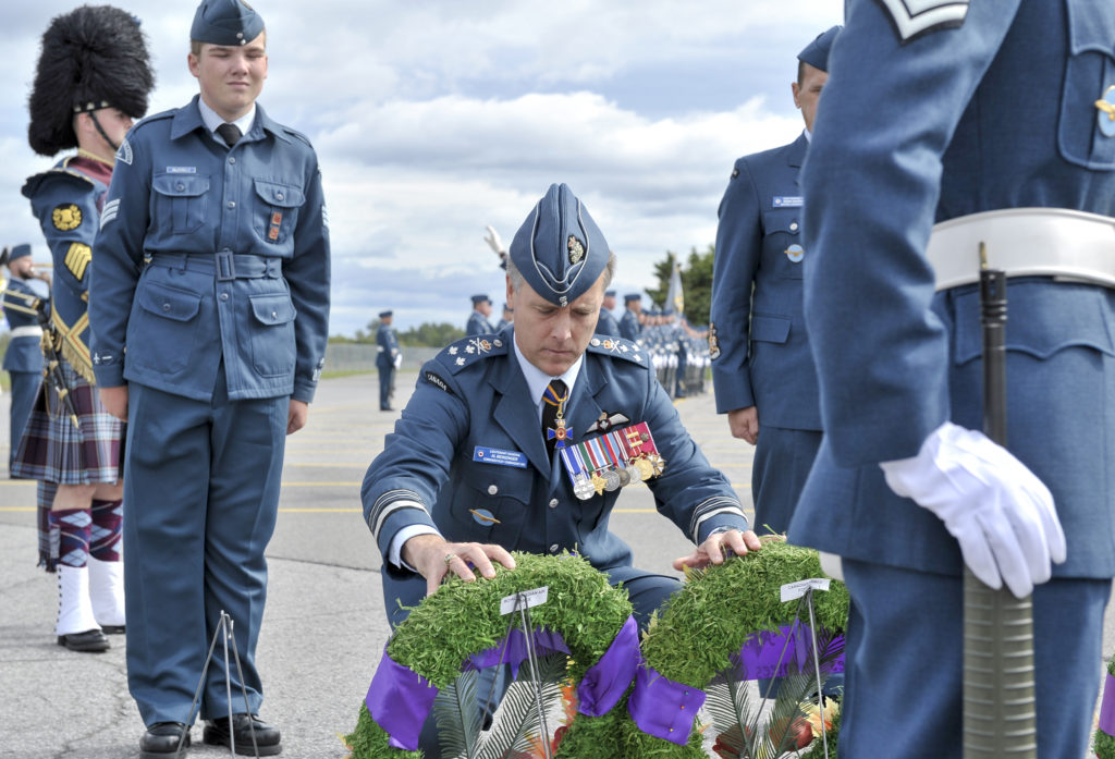 LGen Al Meinzinger, commander of the RCAF, accompanied by a Royal Canadian Air Cadet, lays wreaths during the national Battle of Britain parade held Sept. 15, 2019, at the Canada Aviation and Space Museum in Ottawa. RCAF Photo