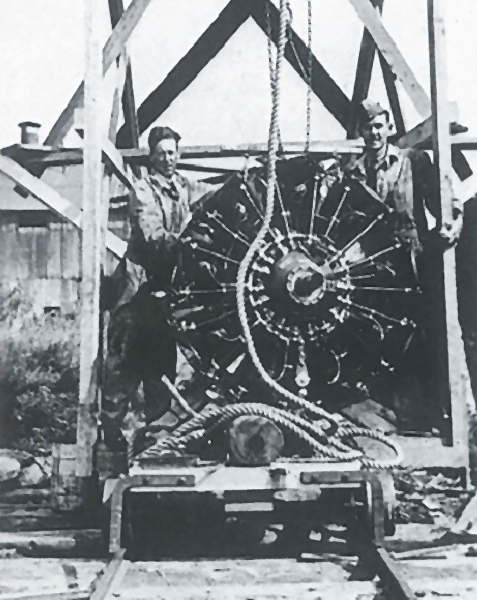 Doan (left) and Rennie stand with the engine change rig at the RCAF seaplane base at Lac Mégantic near the Québec-Maine border. The trolley below them would be run down the rails to the beached and engineless Delta. This is likely the last photograph taken of the two airmen. James Cougle Photo
