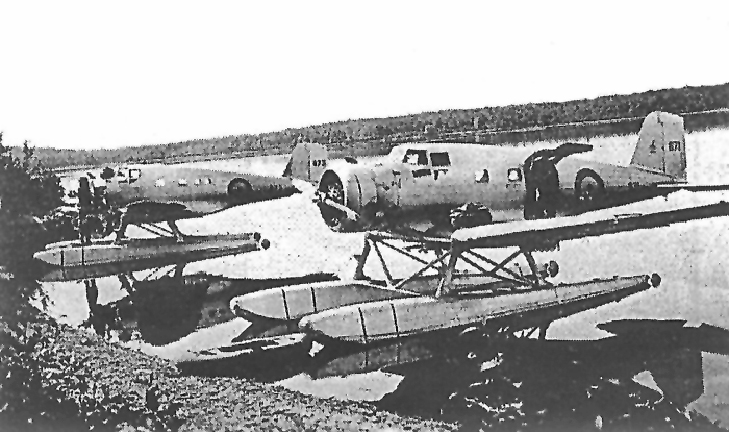 In early Sept. 1939, Northrop Delta 671 from 8 Squadron (foreground) arrives at Lac Mégantic, Que., from RCAF Station Rockcliffe, Ont., with a new Wright Cyclone engine on board. James Cougle Photo