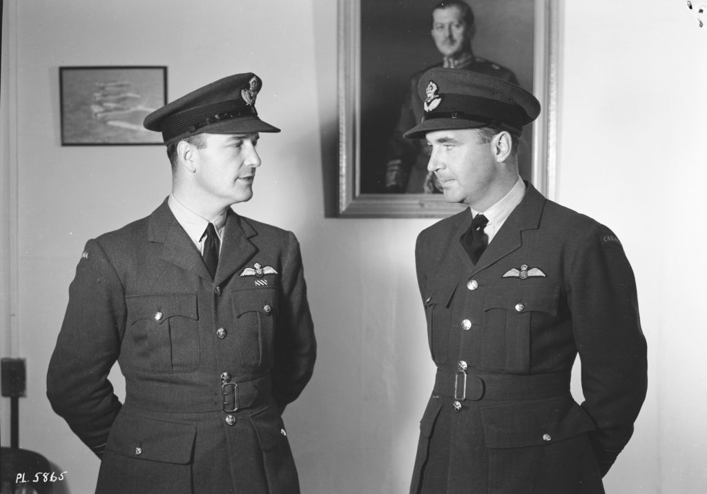 A Sept. 19, 1941, photo of wing commander Gordon Roy McGregor and squadron leader A. Deane Nesbitt. Both were pilots during the Battle of Britain. McGregor became the first RCAF commander of a wing when he helped form the Digby Wing in April 1941; Nesbitt commanded 144 Wing from May to July 1944 and 143 Wing from January to September 1945. RCAF Photo