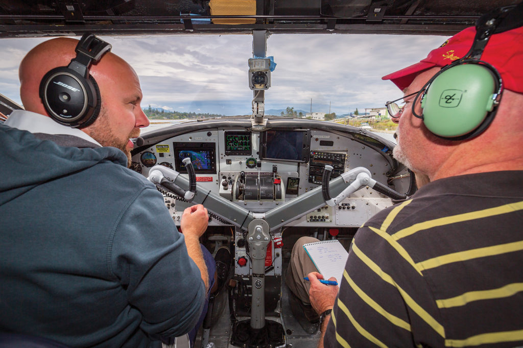 Author Rob Erdos, right, discusses the various flight characteristics of a DHC-3T Otter with Vancouver Island Air's chief pilot, Steve Crerar. Heath Moffatt Photo