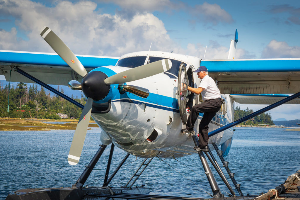Vancouver Island Air founder, operations manager and pilot, Larry Langford, climbs aboard a company DHC-3 Otter to ferry tourists to a nearby resort. Heath Moffatt Photo