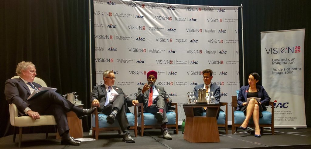 Representatives from several Canadian federal political parties chat the future of Canadian aerospace and aviation with former Quebec premier and deputy prime minister of Canada, Jean Charest. Harjit Sajjan Photo