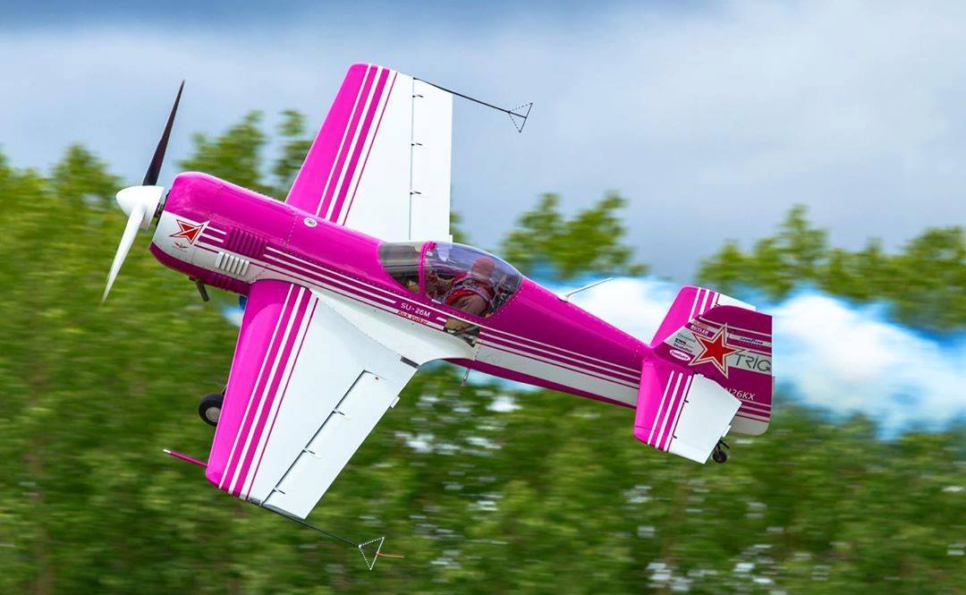 Rick Volken pulls off a daring manoeuvre above Gatineau-Ottawa in his hot pink Sukhoi SU-26M. Photo submitted by Pat Lalande (Instagram user @yvrspotterxrcaf) using #skiesmag.
