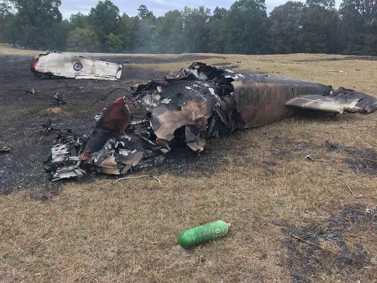 Pieces of the Snowbirds' number-five CT-144 Tutor at the crash site just outside of Atlanta. No one was seriously injured in the incident. Cal Beverly Photo