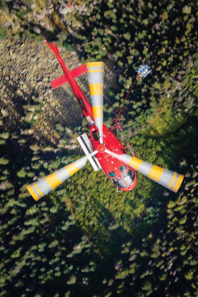 Long line work can be some of the most challenging operations Blackcomb's pilots perform. The company will reserve these flights for its more experienced pilots. Heath Moffatt Photo