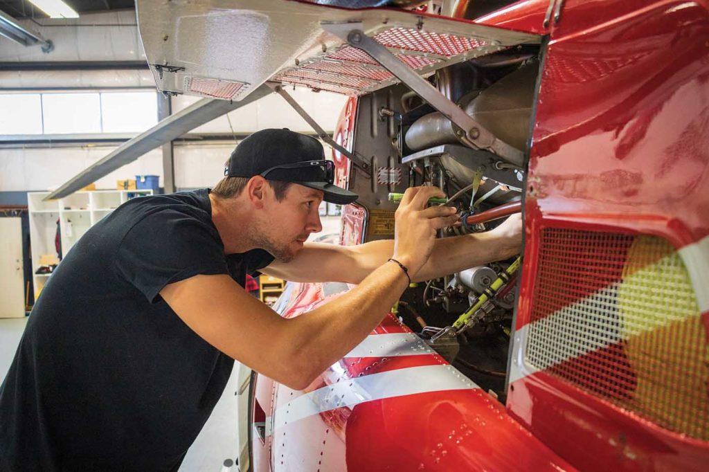 Blackcomb Helicopters AME Josh Paul visually inspects a Bell 407 at the company's Pemberton airport maintenance facility. Heath Moffatt Photo