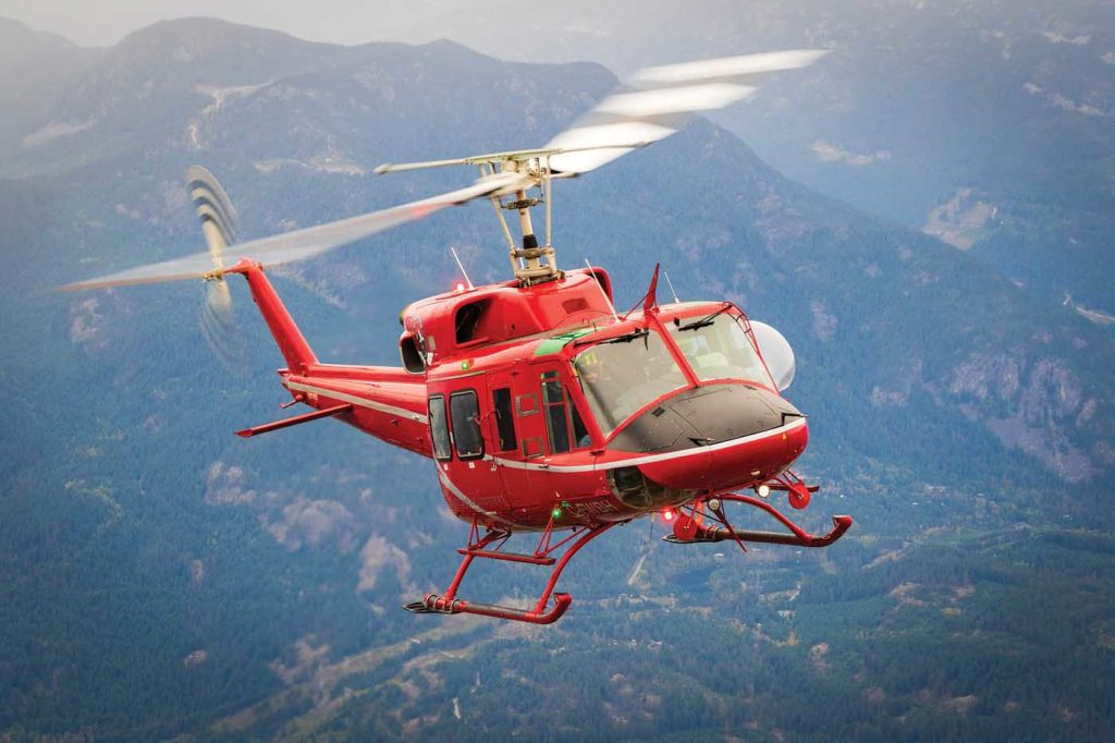 One of three Bell 212 HPs in the Blackcomb fleet. The medium lift aircraft play an important role providing heli-ski service in the winter, and can fly across Canada to fight forest fires in the summer. Heath Moffatt Photo