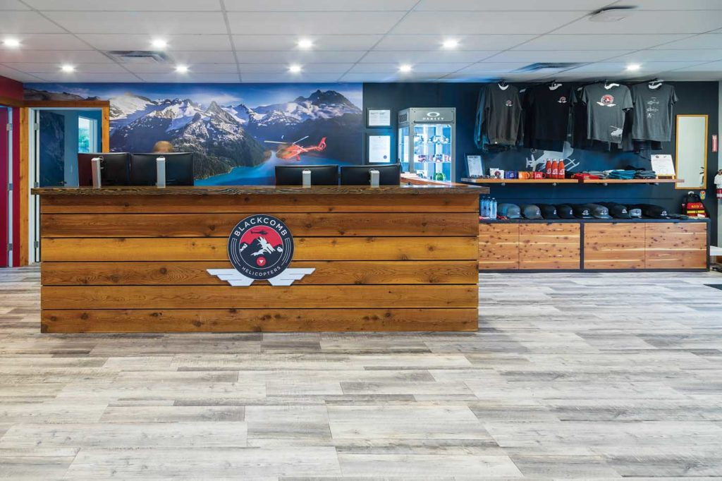 The reception area that awaits passengers when they arrive for an aerial tourism flight. Note the Blackcomb merchandise available on the right of the reception desk. Heath Moffatt Photo