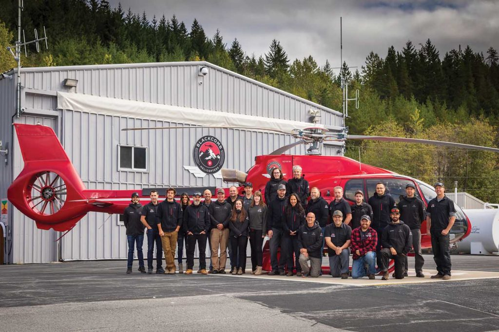 Base personnel at the company's headquarters in Whistler line up outside the hangar. Heath Moffatt Photo