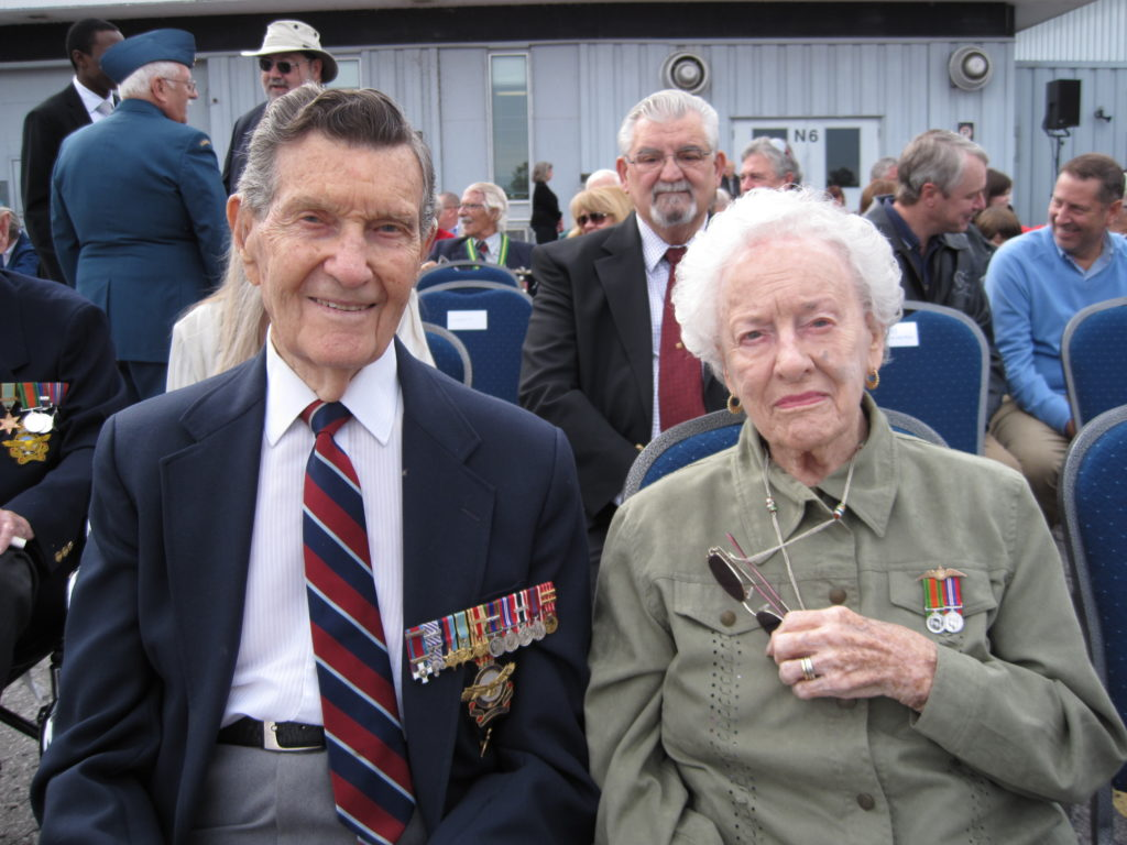 BGen Jack Watts, a veteran of Bomber Command, and his wife Cpl Norma Zelia (Tilley) Watts, a veteran of the Battle of Britain, attend the Battle of Britain parade held at the Canada Aviation and Space Museum in Ottawa on Sept. 15, 2013. DND Photo