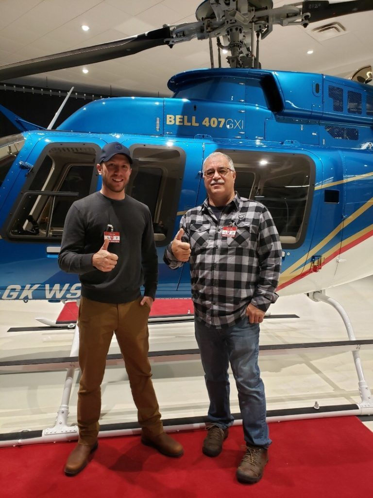 White Saddle Air Services owner Mike King (right) and his son Patrick at Bell's Mirabel, Que., facility for the delivery of White Saddle's new Bell 407GXi. Mike King Photo