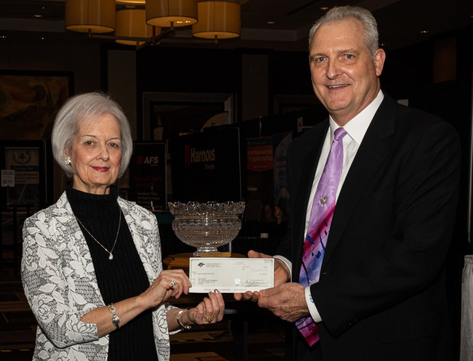 Jack Proctor of Seneca College's School of Aviation accepts the 2019 DCAM award from Jane Abramson. Mike Doiron Photo