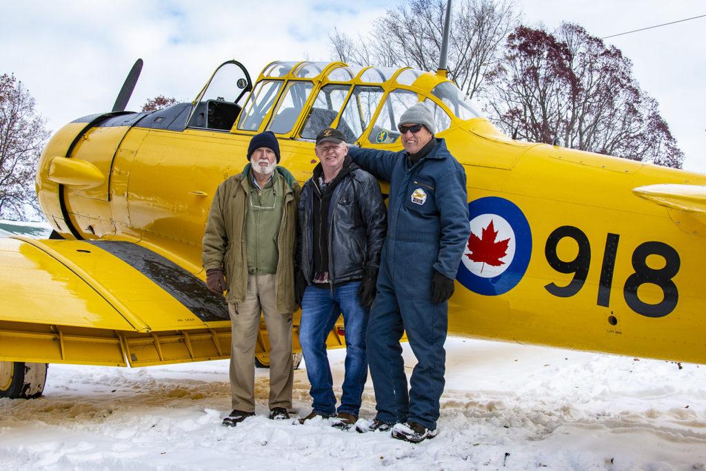Harvard 2918 restorer, Les Balla with current owner Pete Spence and first flight pilot Al Mulder. Eric Dumigan Photo