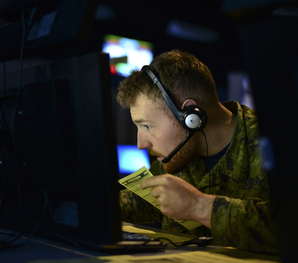 A member of the Royal Canadian Air Force takes part in the Exercise Coalition Virtual Flag 19-4 at Kirtland Air Force Base, N.M., Sept. 10, 2019. The synthetic battle spaces used numerous simulators to connect to 88 systems and 23 sites around the world, synchronizing multi-domain DoD weapon systems along with coalition partners including Canada, The United Kingdom and Australia. USAF Photo