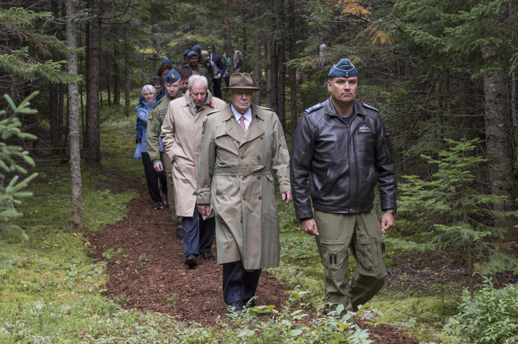 MGen Blaise Frawley, deputy commander of the Royal Canadian Air Force leads the way to the crash site followed by James K. Irving of J.D Irving Limited, Jim Irving of J.D Irving Limited and other guests for the Remembrance service for the 80th anniversary of the Northrop Delta 673 crash. Cpl Nicolas Alonso Photo.