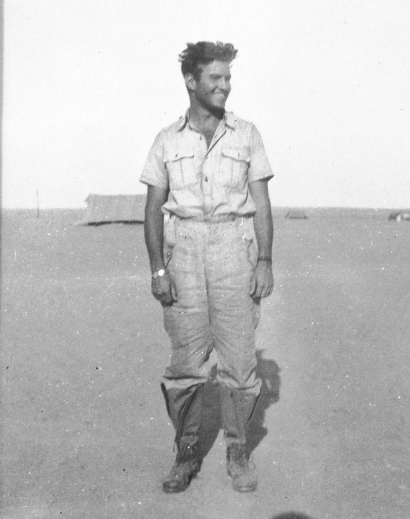 BGen Jack Watts in Tobruk, Libya. He was shot down over the Mediterranean and swam five hours through darkness to safety. He then broke into a German camp -- luckily the day after they abandoned the position. He is still wearing the German clothing he found in the camp as he had discarded his own clothing during his long swim. DND Photo