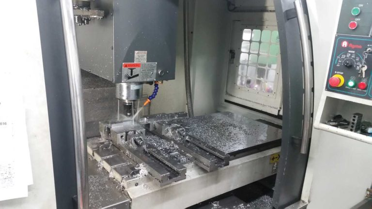 Pictured is ICARUS's 3-axis computer numerical control (CNC) machine, which assists with production and manufacturing of airframe parts and components. ICARUS Photo