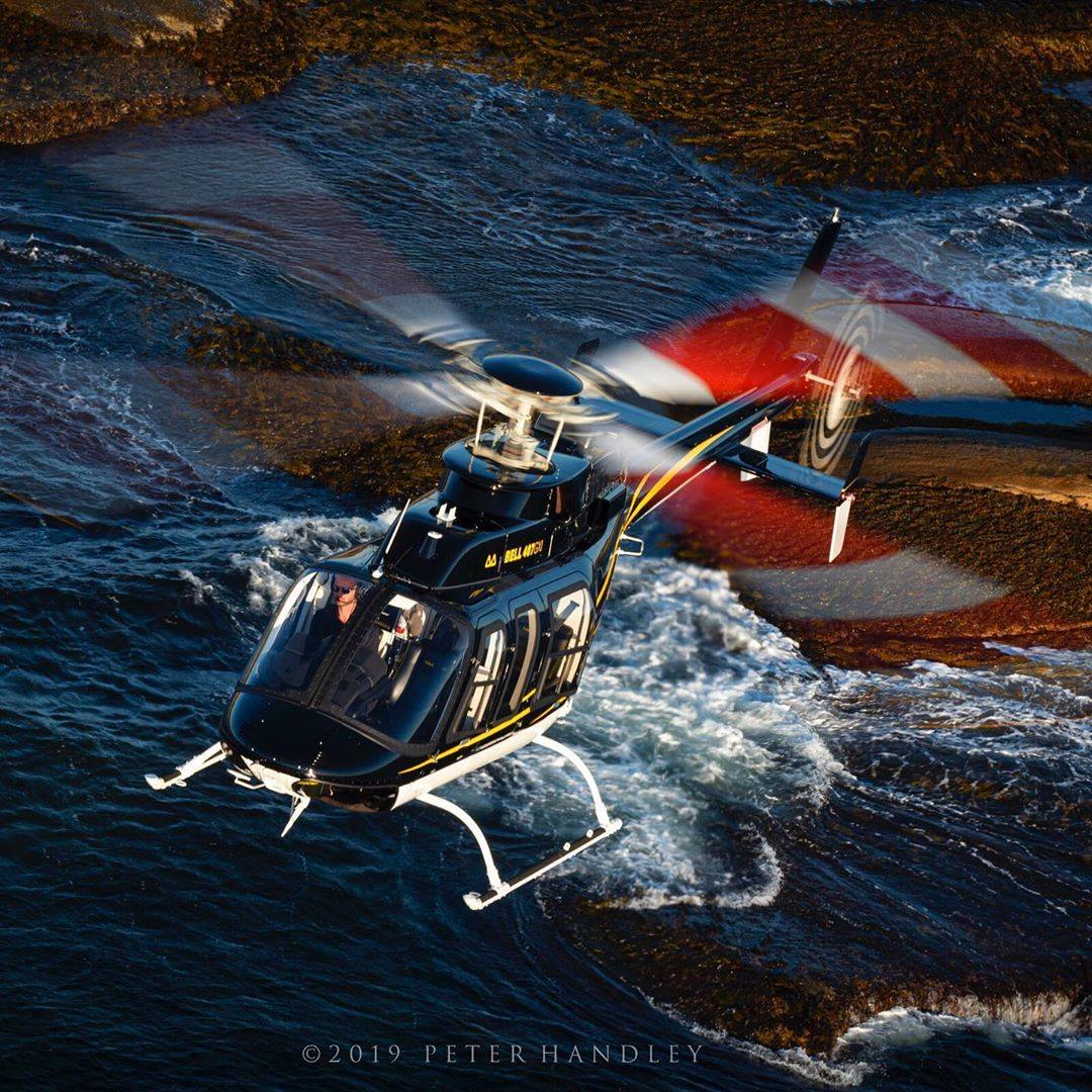 Incredible composition in this shot of a Bell 407 GXi near Peggy's Cove, Nova Scotia. Photo submitted by Peter Handley (Instagram user @phdcreative) using #skiesmag.