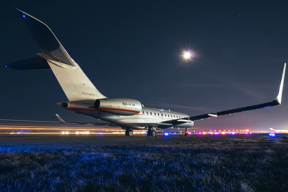 A VistaJet Bombardier Global Express sits patiently on the ramp at Toronto Pearson as a Q400 taxis by to create a stream of light. Photo submitted by Garret Rodgers (Instagram user @rodgersverticalimages) using #skiesmag.