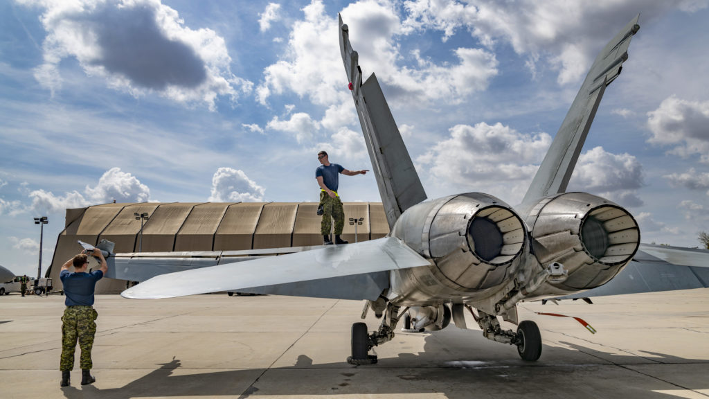 Cpl Benjamin Peddle (left), and Cpl Robin Gagné (right) conduct post flight checks on a Royal Canadian Air Force CF-188 Hornet aircraft after a training flight on Sept. 10, 2019. LS Erica Seymour/RCAF Photo