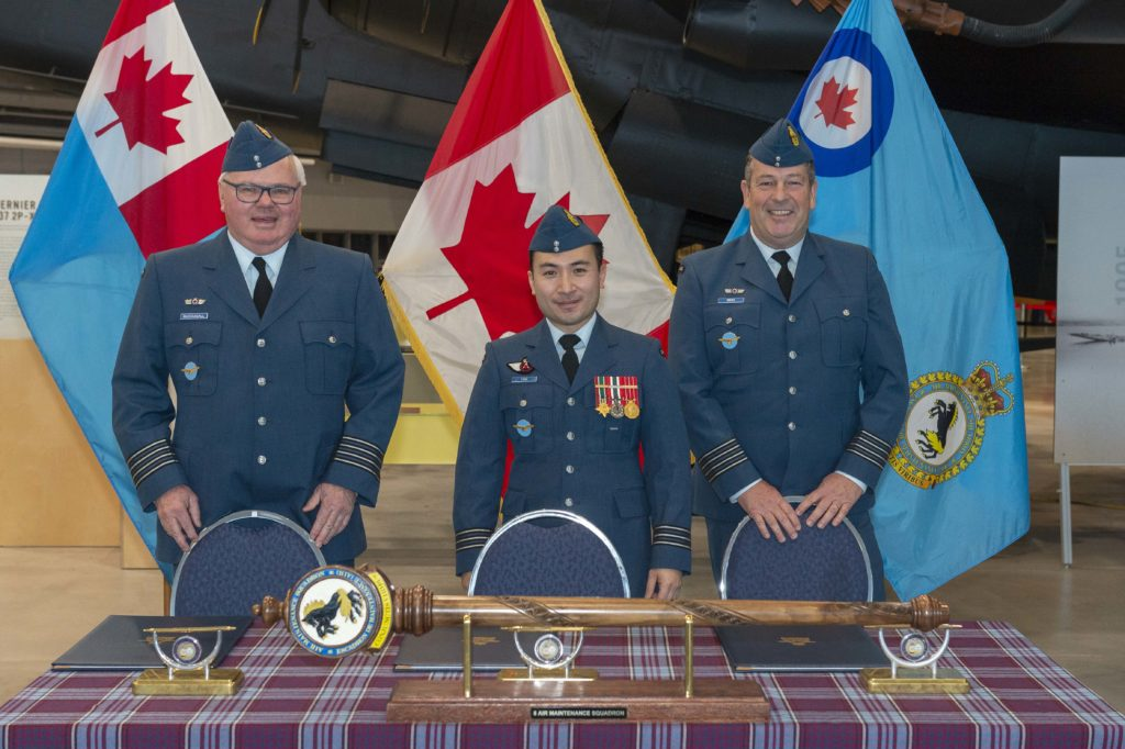 Members of 8 Air Maintenance Squadron attend Honorary Colonel Investiture ceremony on Dec. 2, 2019 at the National Air Force Museum of Canada in Trenton, Ont. Commanding officer LCol Brian Tang, middle, presided over the ceremony and facilitated the transfer of responsibilities from HCol Samuel Reid, right, to HCol Ross McDougall, left. RCAF Photo