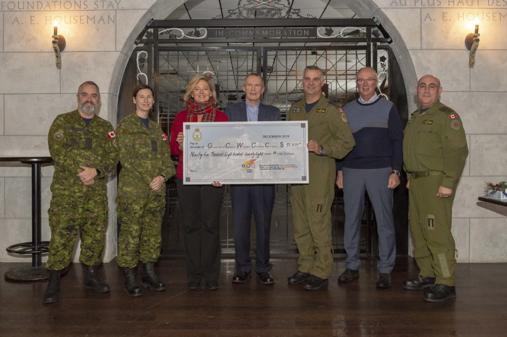 Left to right: 8 Wing CWO Dan Baulne, Maj Kimberly Horan, Brandi Hodge, executive director of the United Way of Hastings and Prince Edward, Tim Bannon, chair of the United Way board of directors, 8 Wing commander Col Ryan Deming, 8 Wing HCol John Smylie, and co-chair of the 8 Wing GCWCC, MWO R.D. Gauthier, gather for the presentation of a cheque for $95,878.19 at the Earl of Bessborough Social House on Dec. 6 2019. RCAF Photo