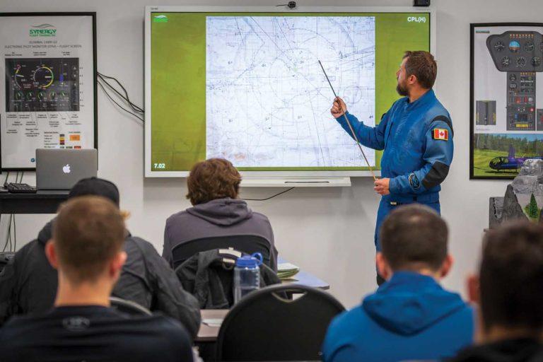 Chief flight instructor James Pantel makes a point during a ground school class. Heath Moffatt Photo