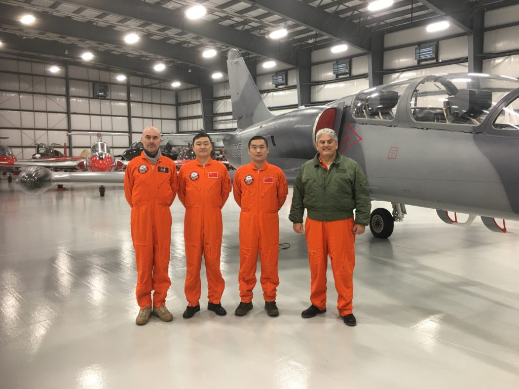 Fred Hauviller, left, head of training at ITPS, with two COMAC pilots currently enrolled on one-year Graduate Test Pilot Course and Giorgio Clementi, right, the president of ITPS. ITPS Photo