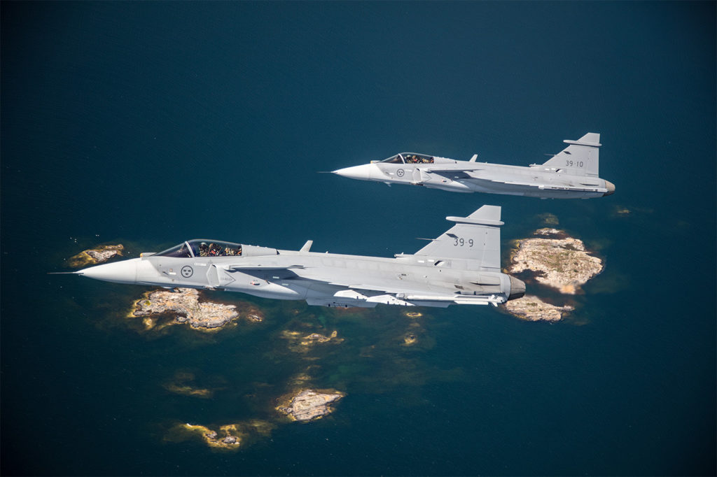 Two of Saab's three flying Gripen E test aircraft, 39-9 and 39-10. The test program of four aircraft has accumulated over 150 hours. Saab Photo