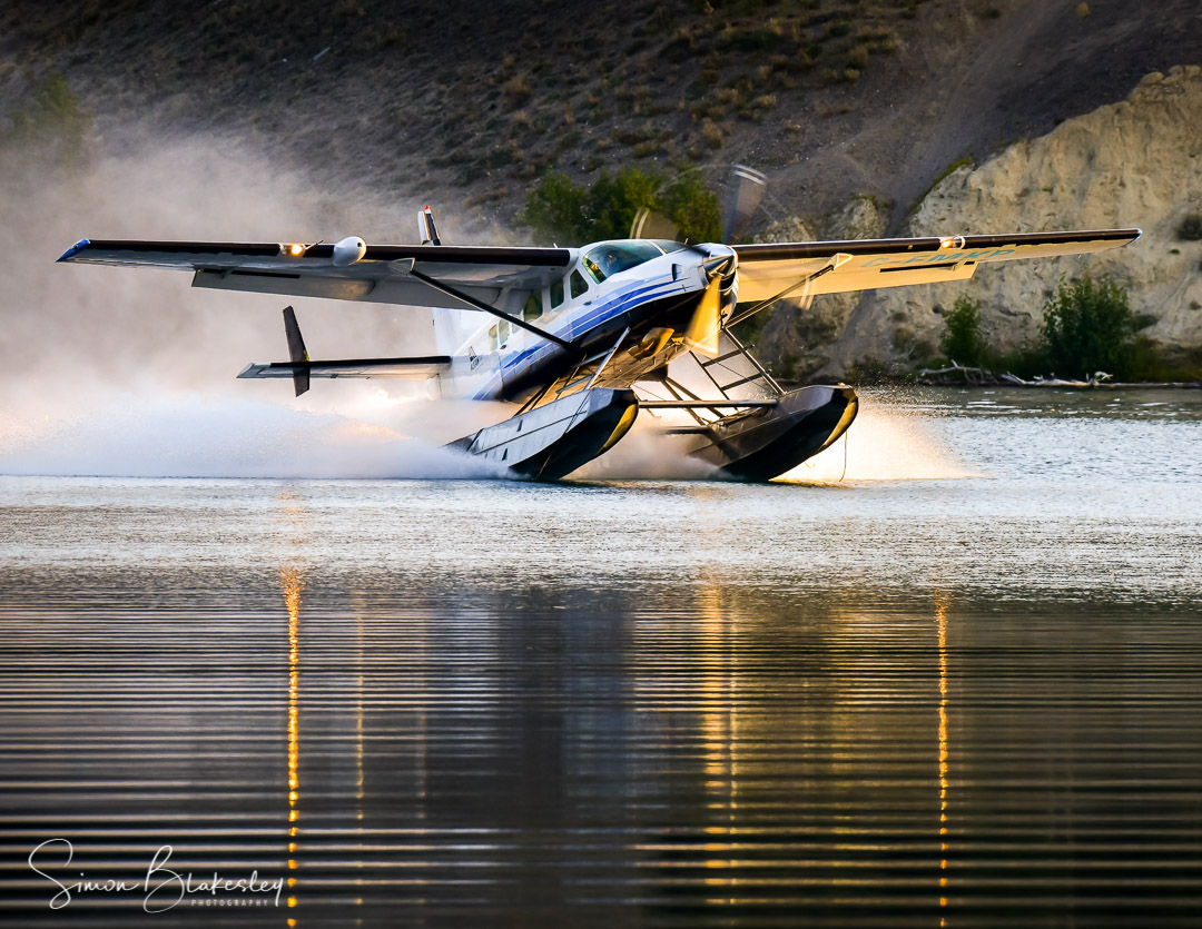 A throwback to warmer times in this shot of an Alkan Air Cessna 208 with the Supervan 900 conversion on Schwatka Lake in the Yukon. Photo submitted by Simon Blakesley (Instagram user @simon_blakesley) using #skiesmag.