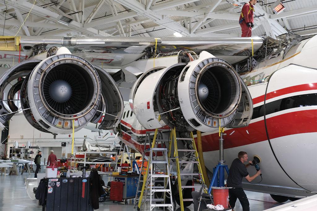 A BAe/Avro RJ-85 qud-jet air tanker undergoes maintenance at Conair's Abbotsford, B.C. base. Howard Slutsken Photo