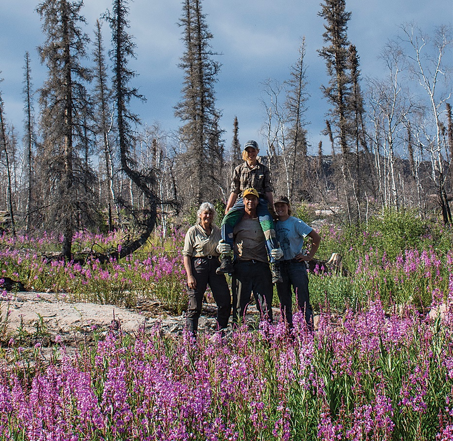 Kristen and Dave, with their daughters Annika and Liv, on the site of the home lost to wildfire in 2014. They have just moved into the new home they built in its place. Kristen Gilbertson Olesen Photo