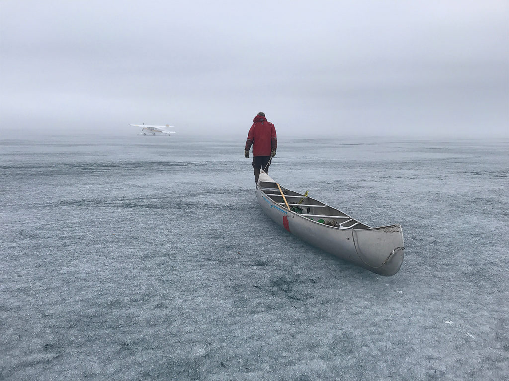 On a foggy June morning, Dave walks on candled ice out to the Bush Hawk -- with his life jacket on. Kristin Gilbertson Olesen Photo