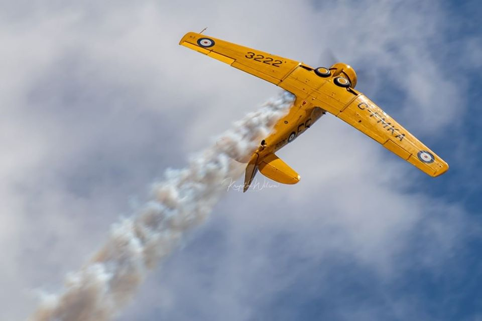A gorgeous shot of a Canadian Harvard Aerobatic Team Harvard letting the smoke fly during a performance above CFB Bagotville. Photo submitted by Krystal Wilson (Instagram user @krystalphotos) using #skiesmag.