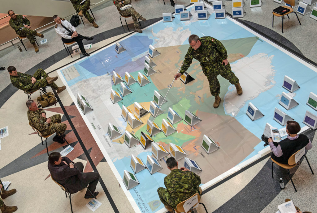 BGen Dave Anderson from the Canadian Joint Operations Command (CJOC) presents during the rehearsal of concept drill on April 3, 2020 in preparation to deploy Canadian Armed Forces personnel under Operation Laser in response to COVID-19. MCpl True-dee McCarthy, Canadian Forces Combat Camera Photo