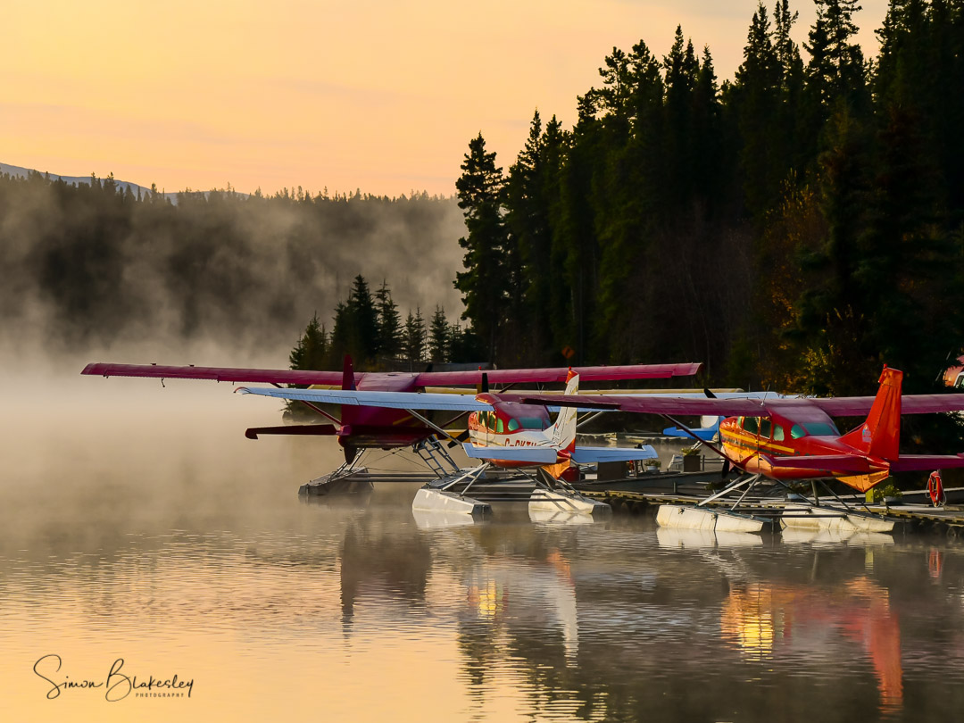 A flock of floatplanes sit on Schwatka Lake in Whitehorse, Yukon after a long winter. Photo submitted by Simon Blakesley (Instagram user @simon_blakesley) using #skiesmag.