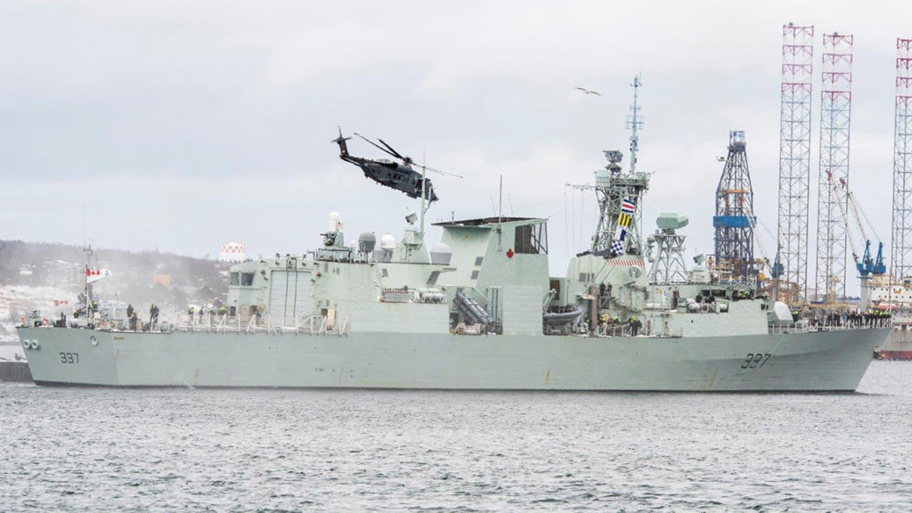 HMCS Fredericton sails away from Halifax on Jan. 20 with its helicopter, named Stalker 22.