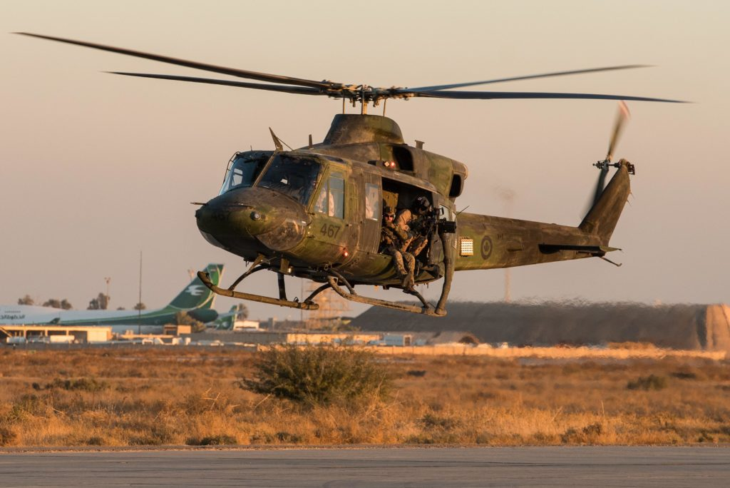 A CH-146 Griffon helicopter from 430 Tactical Helicopter Squadron takes off in Northern Iraq during Operation Impact. DND Photo
