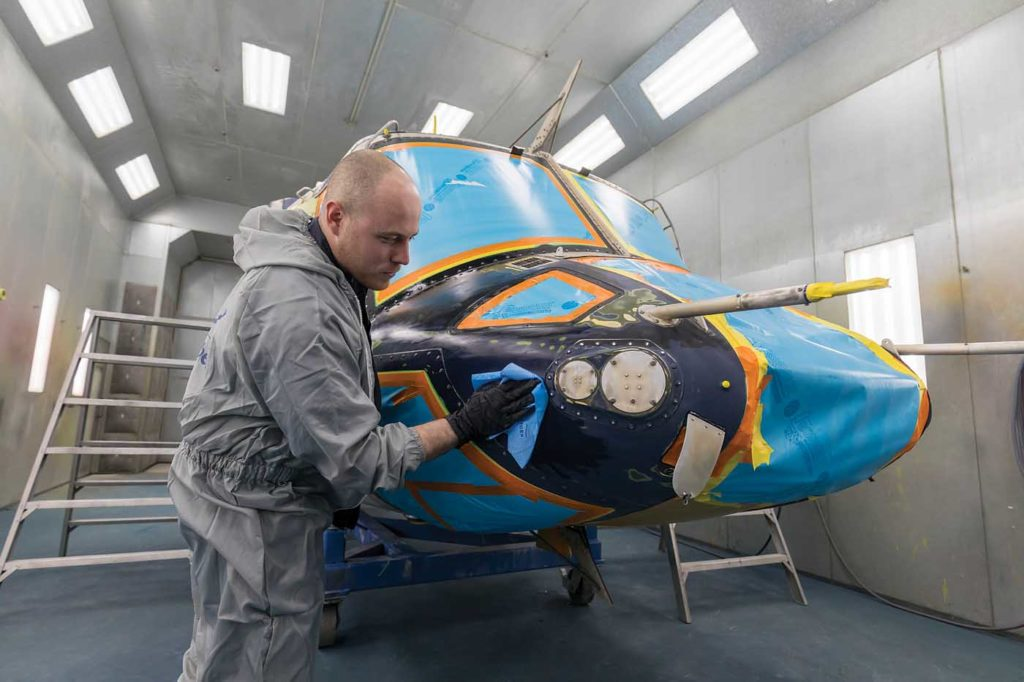 Alpine Aerotech painter Landon Houde preps and cleans a Bell 412 for paint in its Kelowna, B.C., facilities. Heath Moffatt Photo