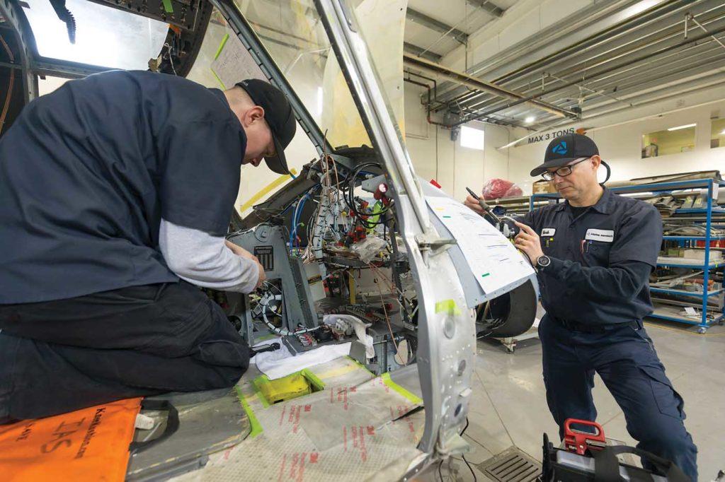 Avionics technicians Mark Jensen and Andre Forget working on an avionics upgrade for a customer's Bell 212. Heath Moffatt Photo