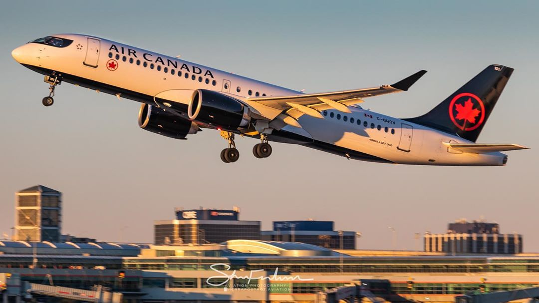 An Air Canada Airbus A220 departs Toronto Pearson during golden hour. Photo submitted by Instagram user @sierrafoxtrot.aviation by tagging @skiesmag.
