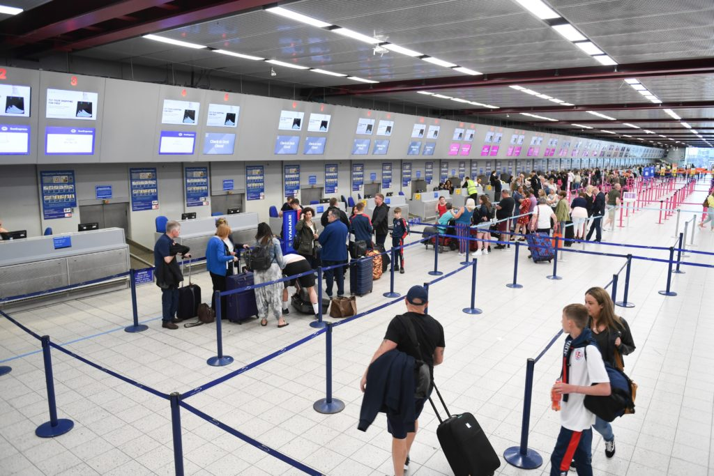 Airport passengers - Phil Mosley/Unsplash Photo
