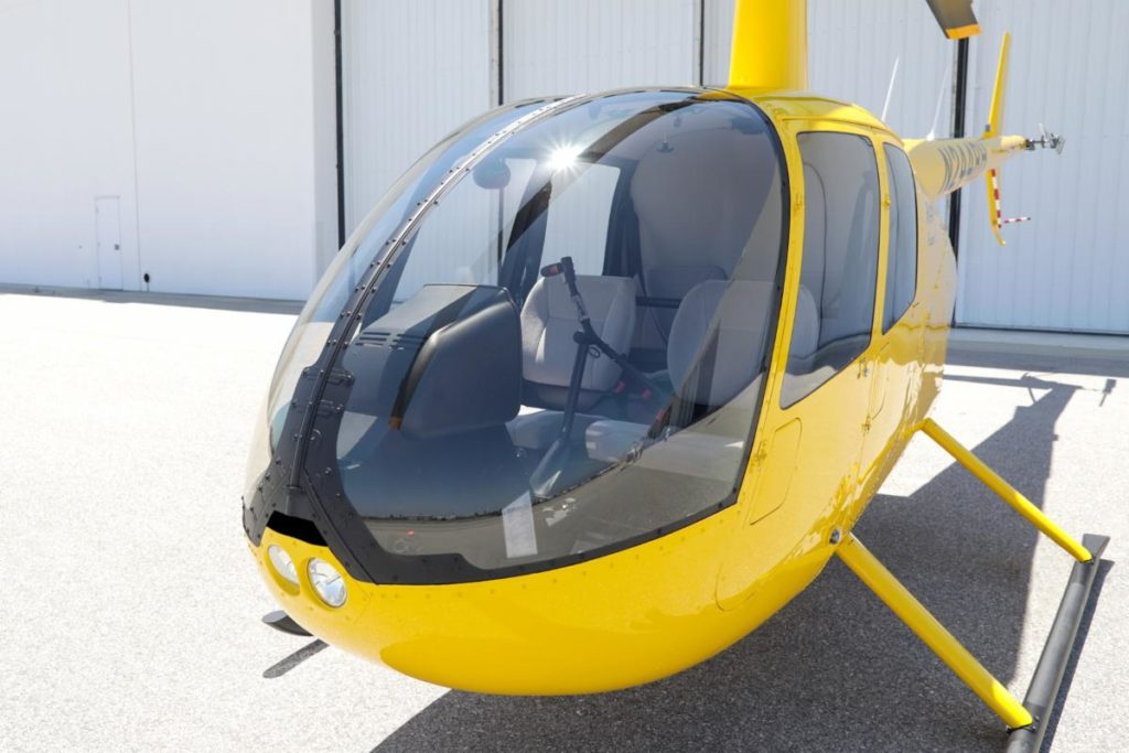 The new windshields are constructed of tough, energy-absorbing polycarbonate (standard windshields are made of acrylic) and installed with distinctive retention hardware. Robinson Photo